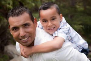 Hispanic Father and Son Having Fun Together in the Park